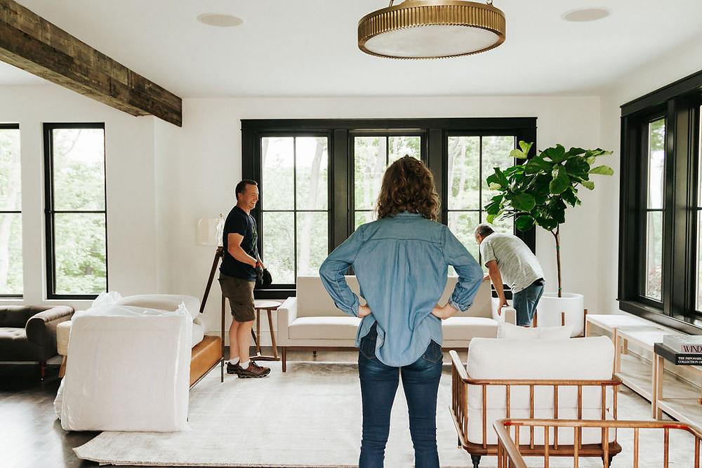 Interior Designer Lauren Figueroa installing a living room project