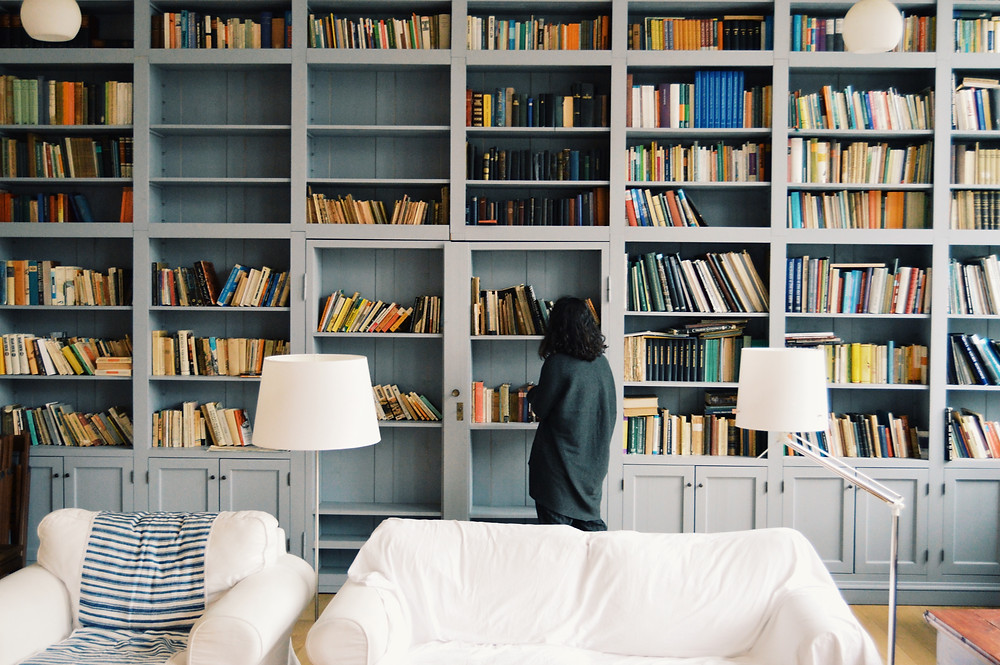 Sweeping light blue bookcases.
