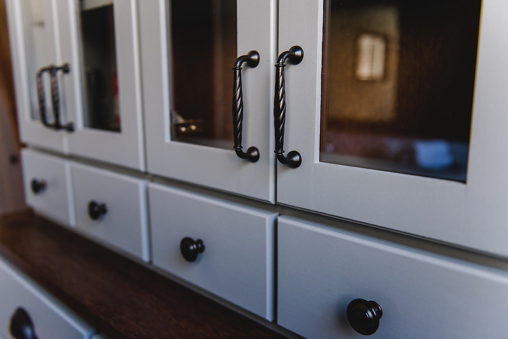 A close-up of the cabinet handles.