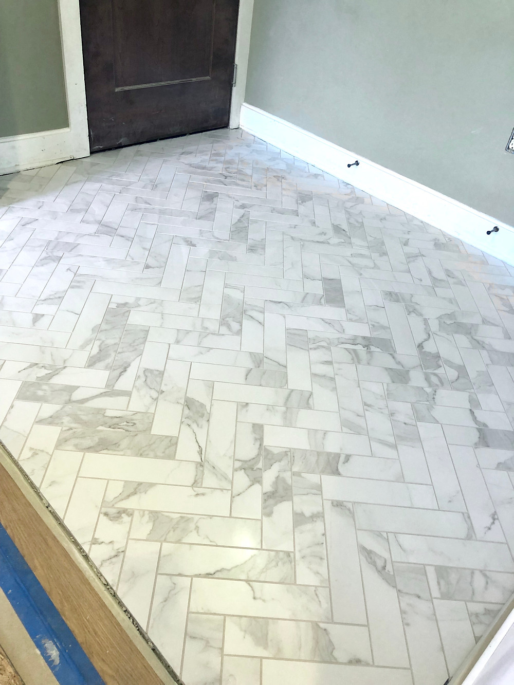 herringbone marble tile in a foyer