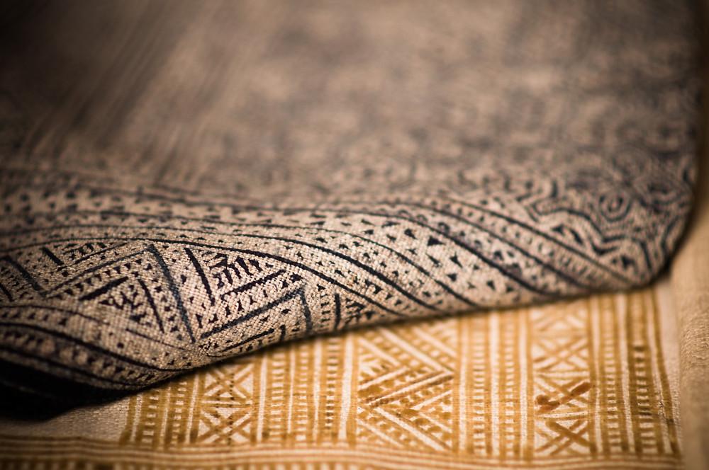 A black and brown geometric rug.