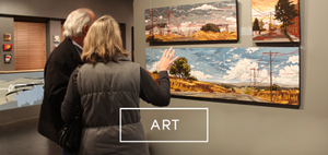 A couple browsing scenic art at LaFontsee Galleries.