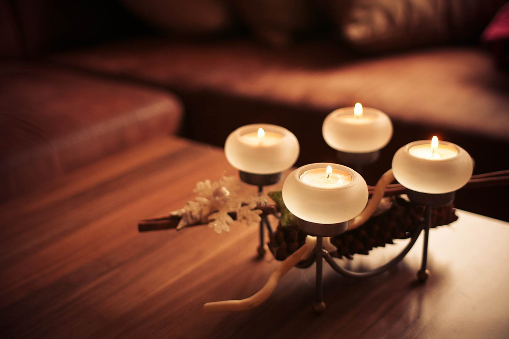 A set of four tea candles.