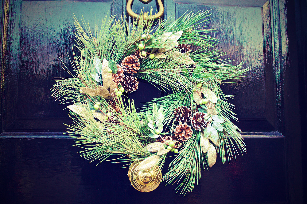 A natural wreath with pinecone accents.