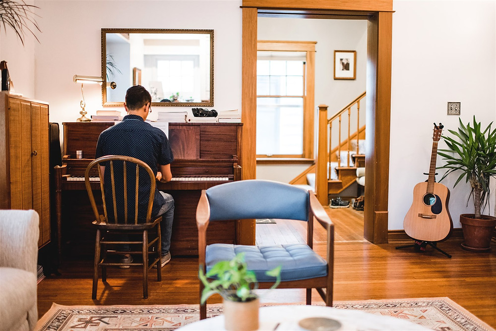 Man playing the piano in the living room