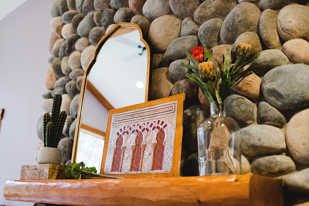 A close-up shot of the wood and stone mantel.