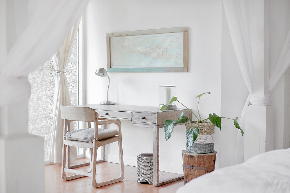 A minimalist room with a white desk.