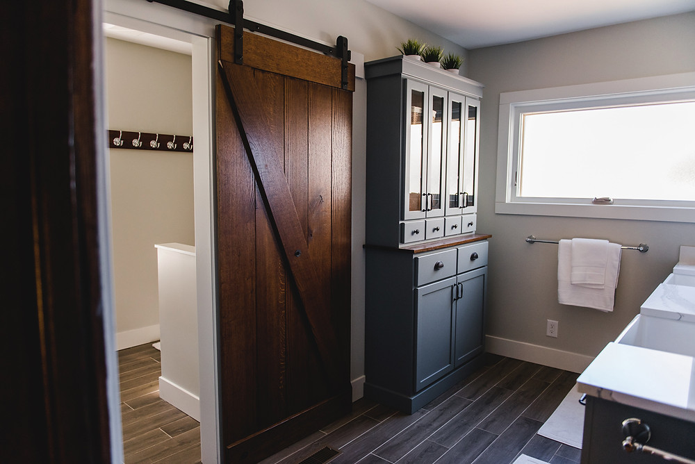 The sliding barn door separating the two spaces.
