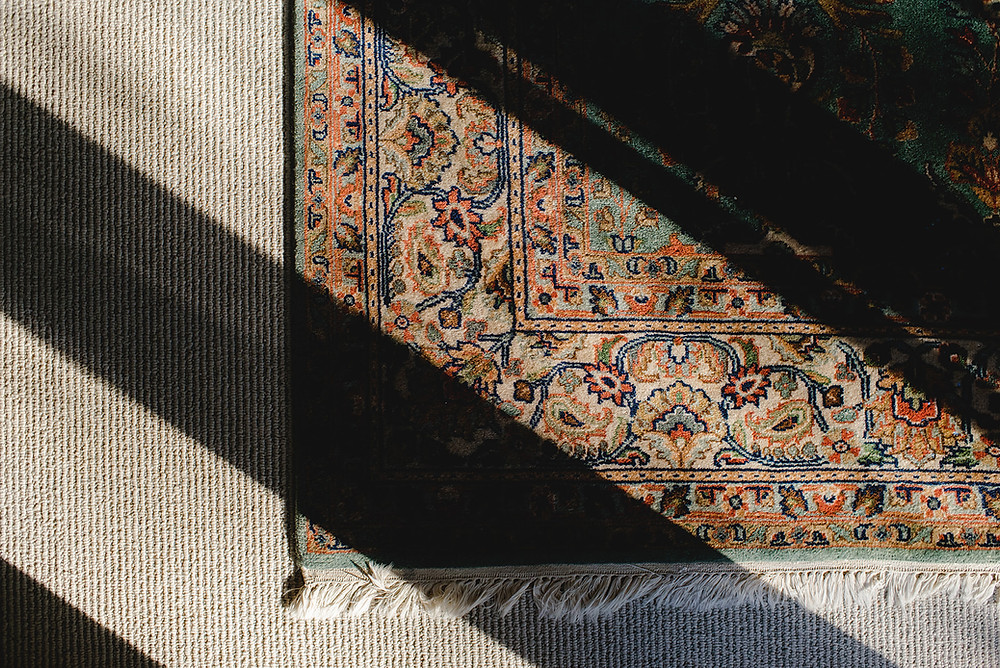 Can I lay an area rug over carpet? Short answer, Yes!