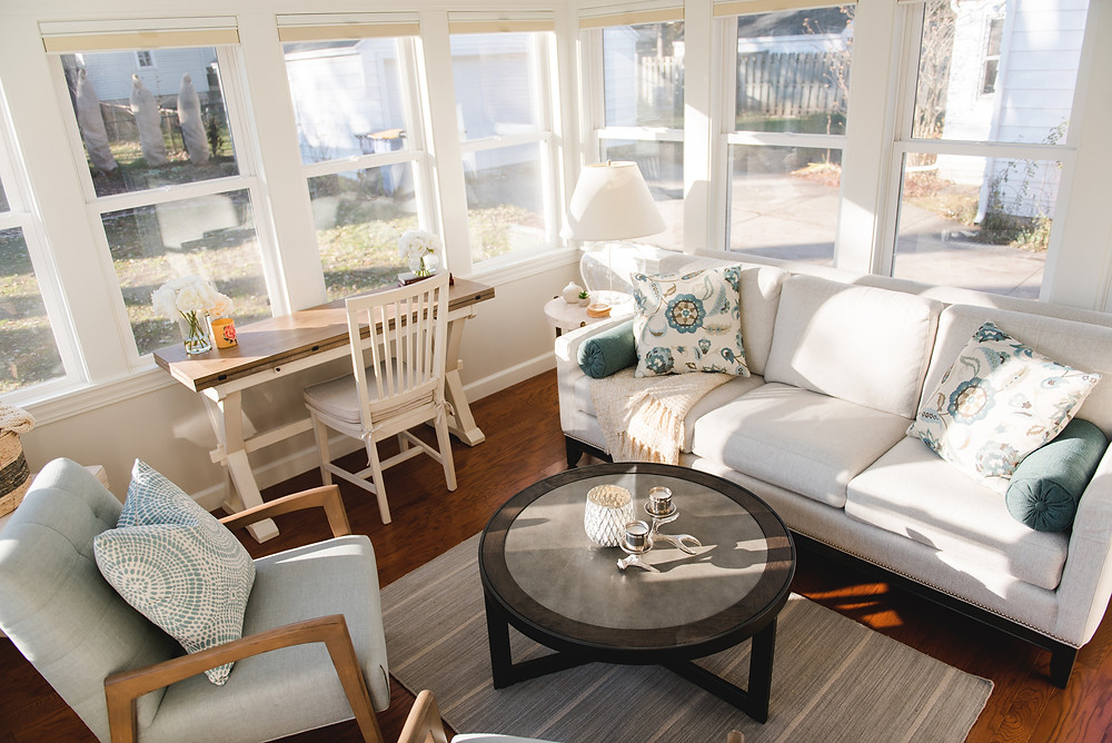 A bright and airy sunroom designed by Lauren Figueroa.