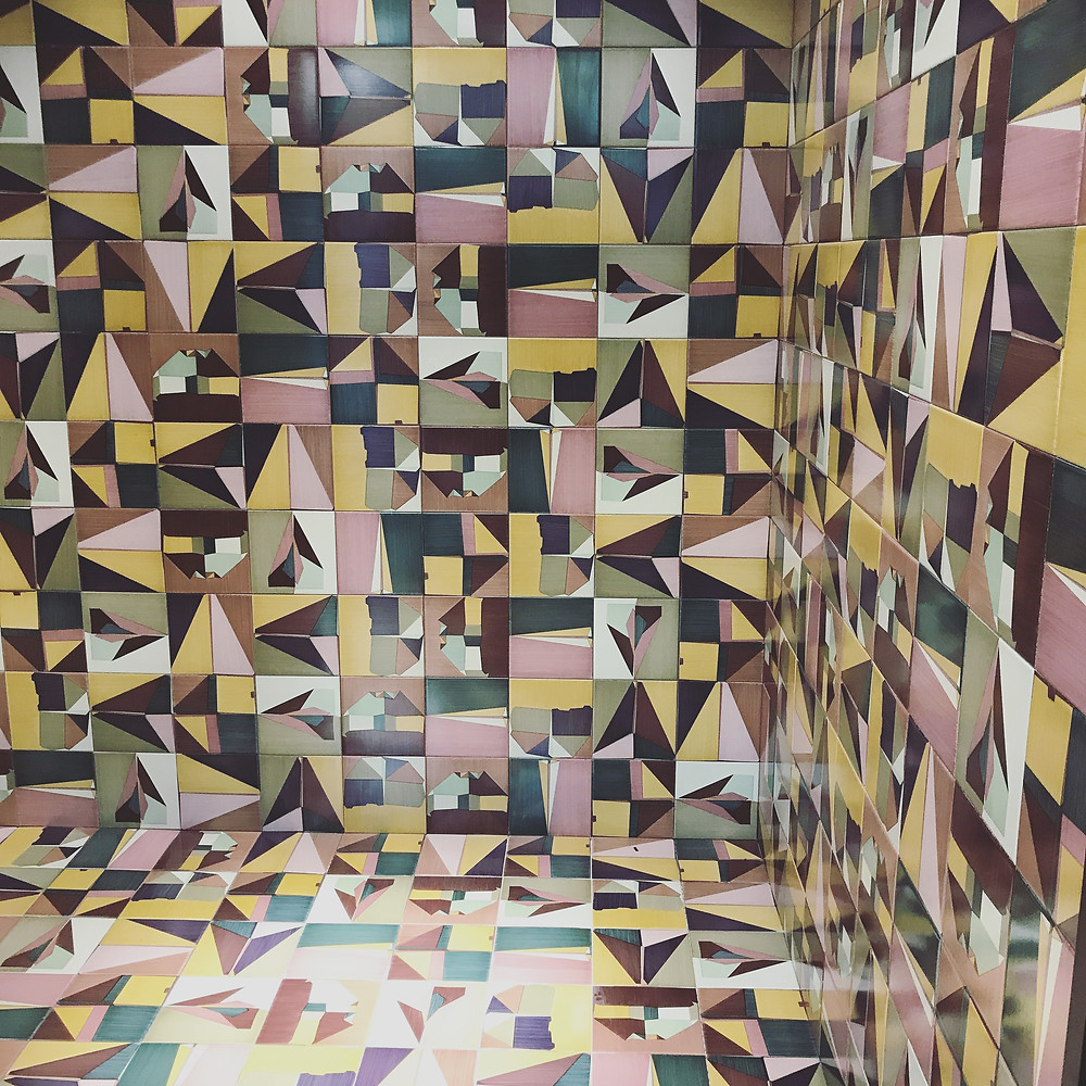 A display of colorful geometric tile at Cersaie 2017.