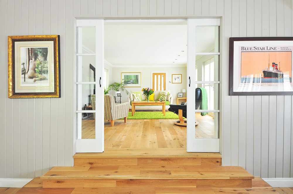 A warm entryway opening into a room with lemon and lime accents.