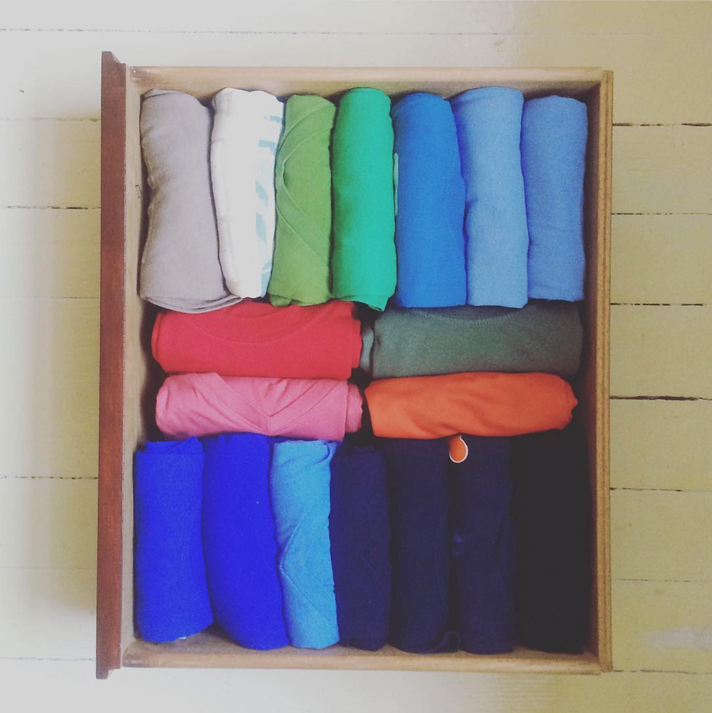 A drawer full of clothes folded using the Marie Kondo method.