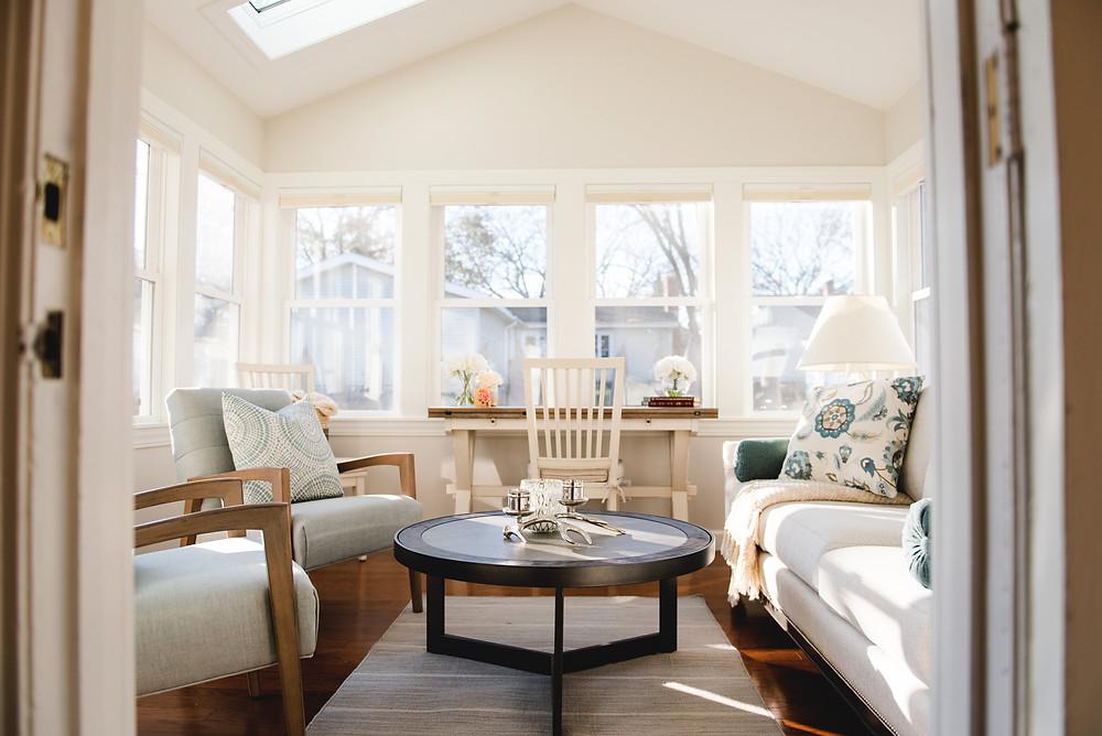 A four seasons room designed by Lauren Figueroa Interior Design.