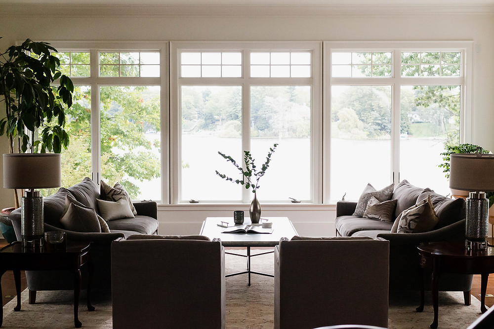 a living room with a lake view designed by lauren figueroa