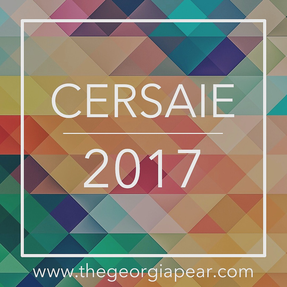 """A colorful geometric image with the text, """"Cersaie 2017"""" over it."""