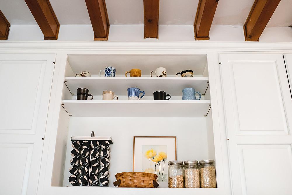 Artistically arranged kitchen shelves by Lauren Figueroa Designs.