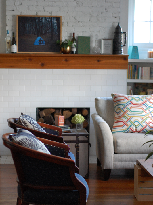 A brick fireplace brings texture and life to a room.