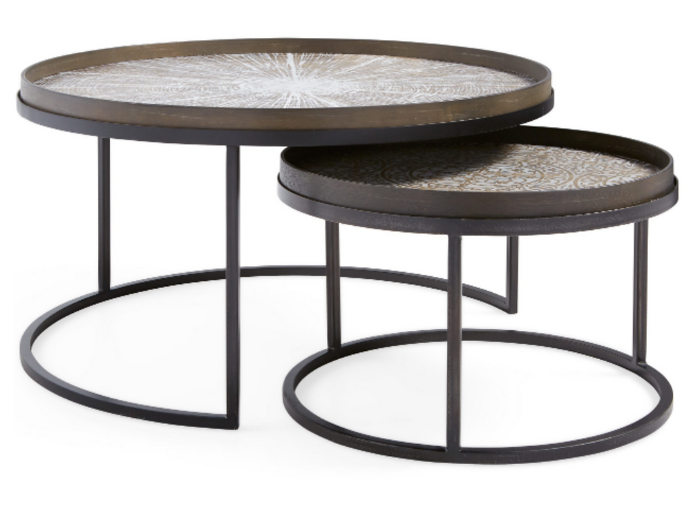 A set of two round tables that can be layered, selected by Lauren Figueroa.