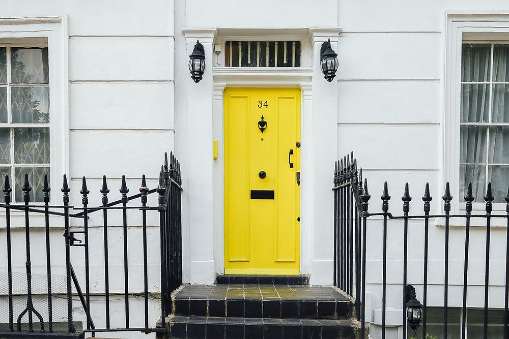 A front door painted bright yellow.