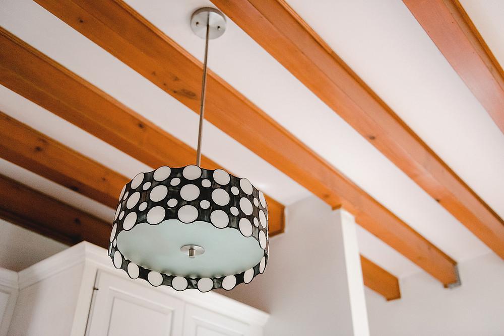 A lighting fixture in the home of Lauren Figueroa, lead designer.