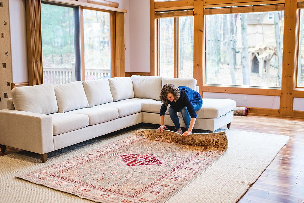 Lauren Figueroa arranging the rug.