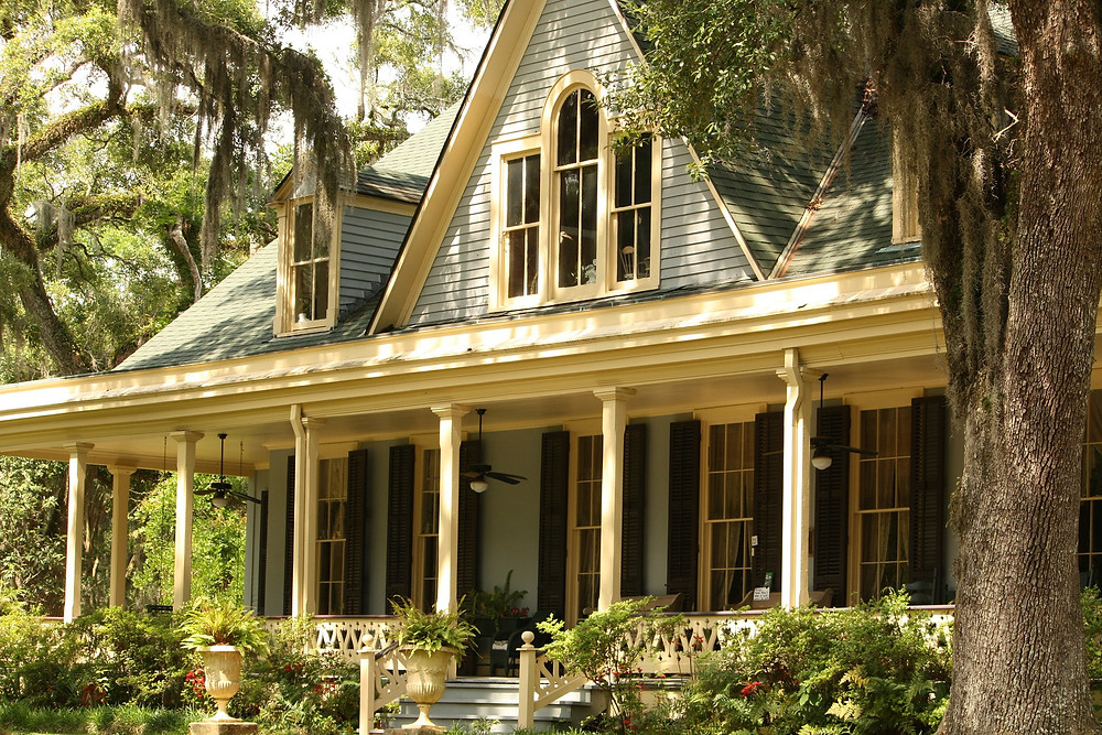 A gorgeous house with a welcoming front porch.