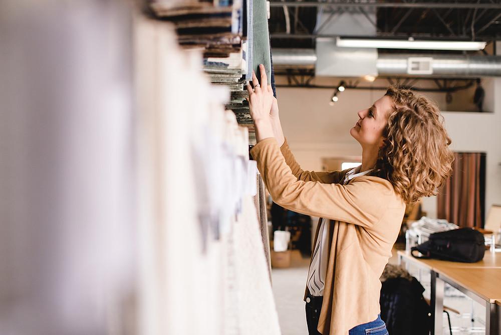Interior designer selecting upholstery fabrics