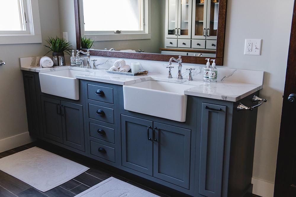 A calming blue vanity in a bathroom design by LF Designs.