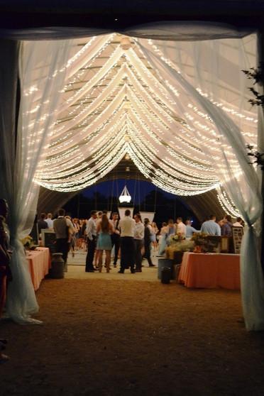 An evening wedding reception under the lights