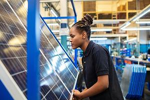 Quality-engineer-examining-solar-panels-