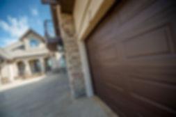 Traditional wooden long panel garage door