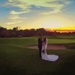 Bride and groom on sunset view