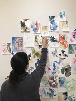 Painter, Elise Morris installing her work.