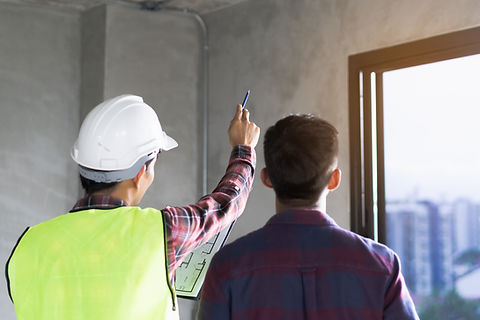 Client and Contractor discussing plan to