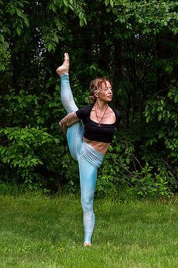 Gina Mandella practices bird of paradise yoga pose