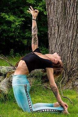 Yoga instructor Gina Mandella practices camel pose