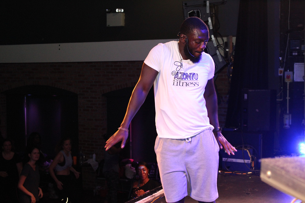 Kwaku delivering Azonto Fitness at the last Fitness Blastoff event