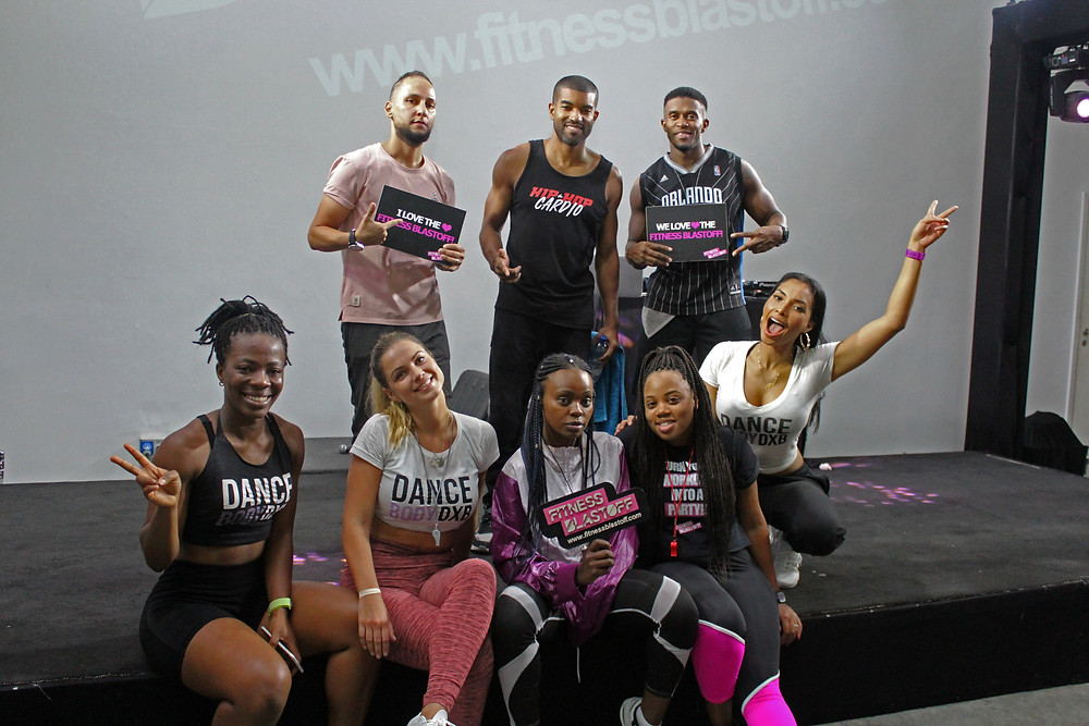 Instructors posing on stage