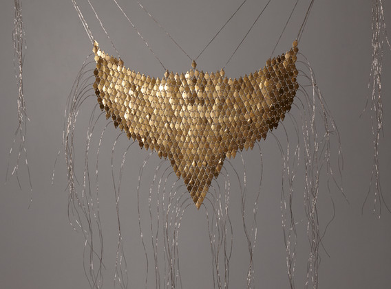 Defne Tutus Rough Elegant Beast! brass sequins & string 7 x 8.5 inches (strings flow down 36 inches total)  2020
