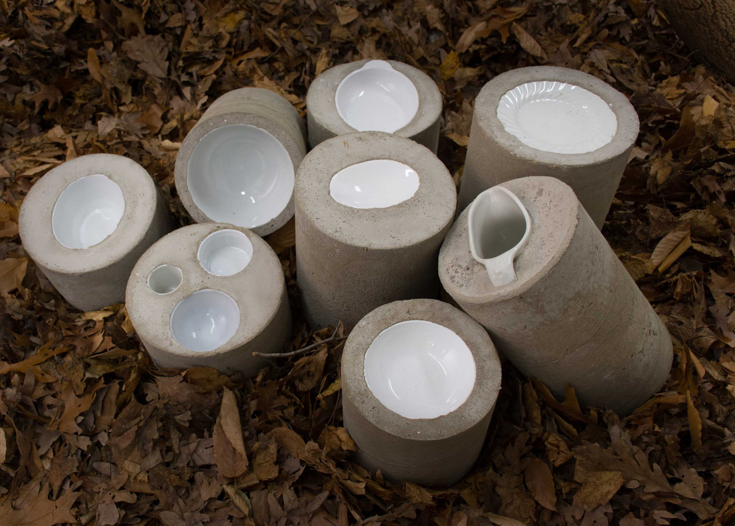 "Ruth Borgenicht ""Concrete Crockery"" 2016, tableware imbedded into concrete cylinders, 5""-12"" high"