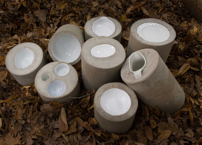 """Ruth Borgenicht """"Concrete Crockery"""" 2016, tableware imbedded into concrete cylinders, 5""""-12"""" high"""