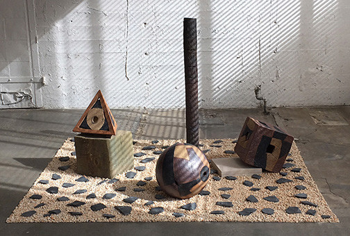 Cube, Pyramid & Sphere, 2017 48 x 78 x 70 inches, high fired clay pigmented with oxides, wood found in the ocean, river gravel, limestone and slate smashed to bits.