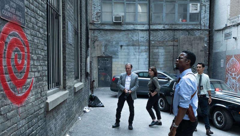 Richard Zeppieri, Edie Inksetter, Chris Rock, and Max Minghella in Spiral c/o Lionsgate