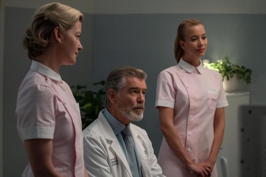 Gretchen Mol, Pierce Brosnan, and Sabina Gadecki in False Positive c/o A24/Hulu