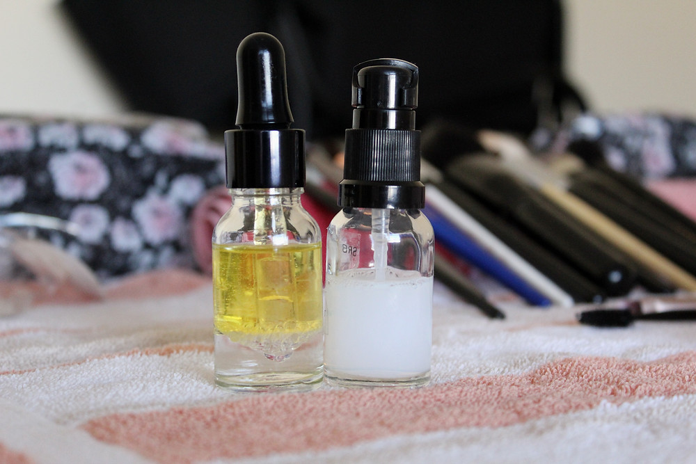 Glass bottles holding liquid skin care products