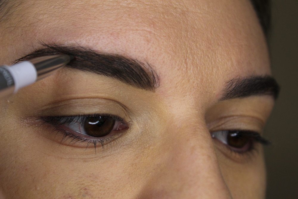 Filling in my eyebrows.