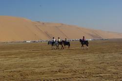 Riding off into the Liwa Desert