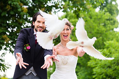 Groom and bride doing white dove release for wedding