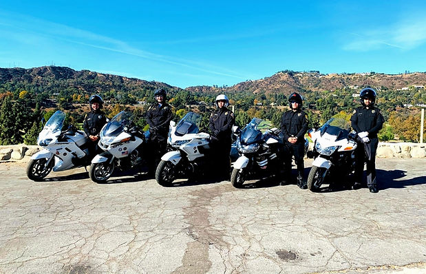 Team of Motor Escorts / Motorcade Officers lined up for a photo shoot